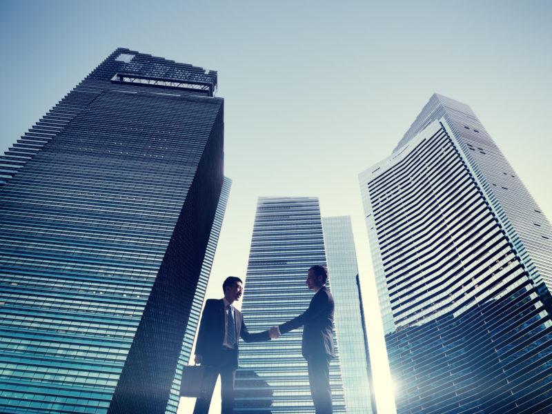 Businessmen Cityscape Handshake Partnership Concept