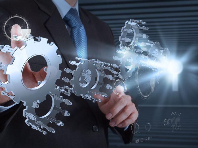 20101264 - businessman hand draws gear to success concept